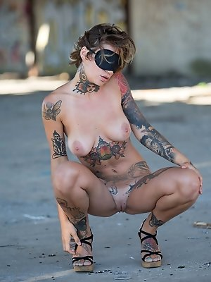 Stacy Cloud shows off her tattooed body outdoors.